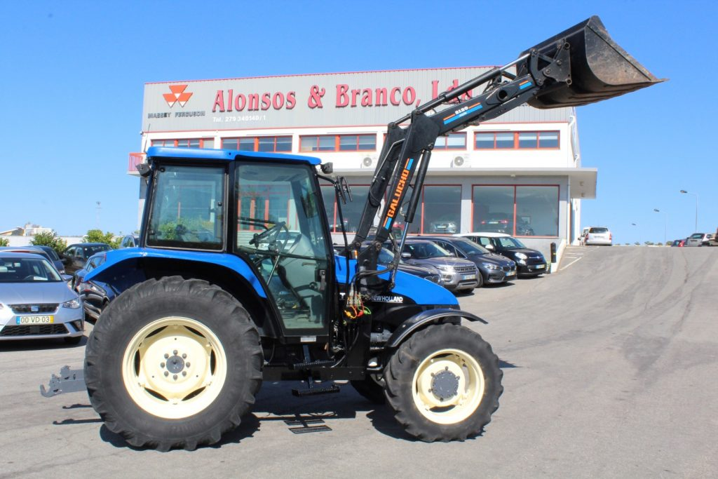 NEW HOLLAND TL 70 cheio